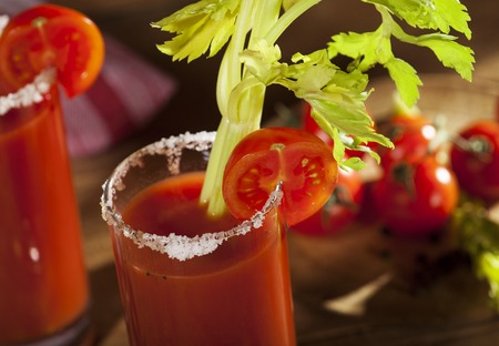 Bloody Mary cocktail on a wooden background