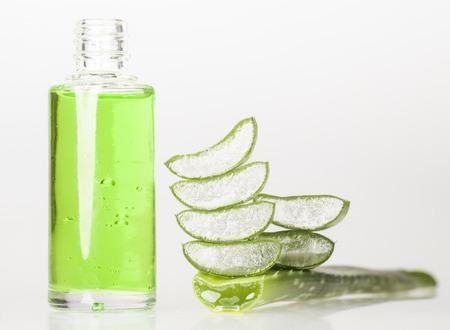 aloe vera: Aloe vera essential oil isolated on white background