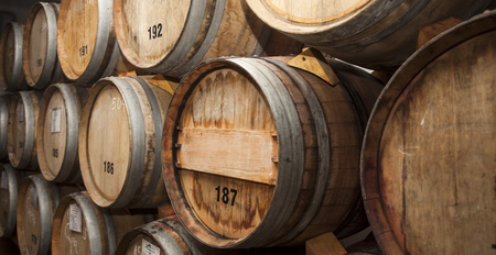 stacked oak barrels. Stock Photo - Wine Barrels In Cellar. Cavernous Cellar With Stacked Oak L