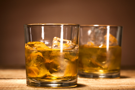 shooter drink: Glasses of scotch on wooden vintage background