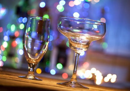 Empty glasses on table in night club