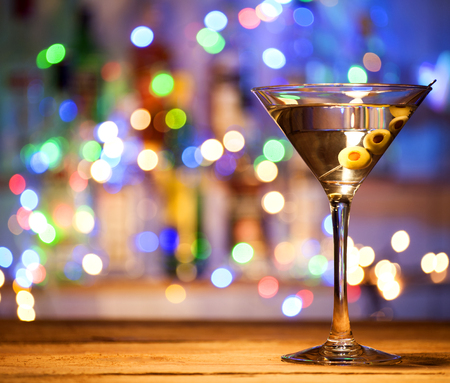 Glass of a martini coctail in a bar