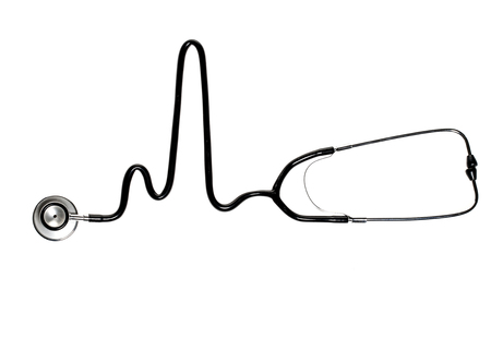 Stethoscope in the shape of heart beat isolated on a white background.