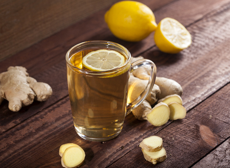Ginger tea with lemon on a wooden background Stock Photo