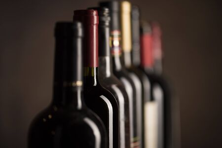 Wine buttles collection on dark background