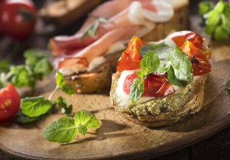 Mini sandwiches food set. Brushetta or authentic traditional spanish tapas for lunch table. Delicious snack, appetizer, antipasti on party or picnic time. Banco de Imagens