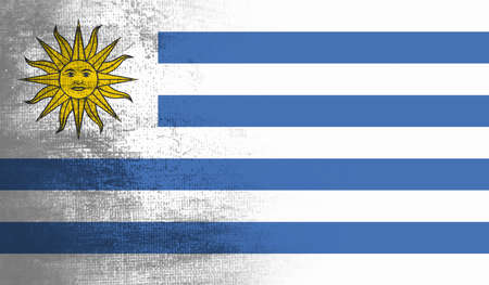 Uruguay flag with waving grunge texture. Vector background.