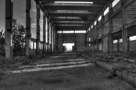 heavily: ruins of a very heavily polluted industrial factory monochrome