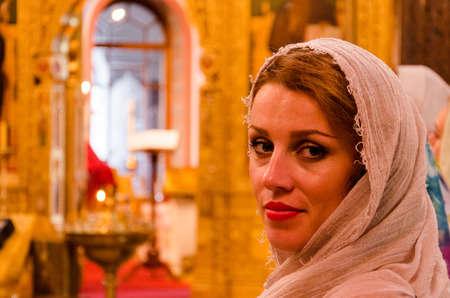 the believer: Beautiful girl believer in the church