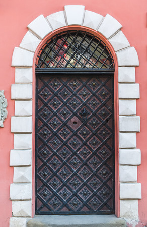 handle bars: Old medieval door in a house in the center of Lviv