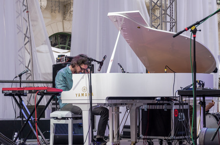 playing the market: Lviv Ukraine June 2015: Alfa Jazz Fest 2015. Musician Contrast Trio band playing piano on stage jazz festival on the Market Square in Lviv near the town hall Editorial