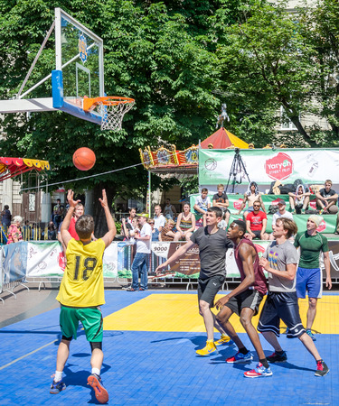 fest: Lviv, Ukraine - July 2015: Yarych street Fest 2015. Street basketball competition at the festival near Lviv Opera House. Players f Editorial