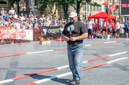 strongest: Lviv, Ukraine - July 2015: Yarych street Fest 2015. The Worlds Strongest Man Vasyl Virastuk referee strongmen competitions Editorial