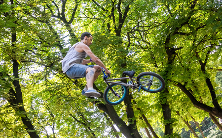bmx bike: Lviv, Ukraine - July 2015: Yarych street Fest 2015. Extreme jumping on a BMX bike and perform stunts in the air Editorial