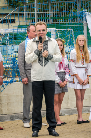 dynamo: Lviv, Ukraine - July 2015: Ukrainian Cup water polo in the pool SKA. Lviv Mayor Andriy Sadovy congratulates the team Dynamo Lions in water polo with the conquest of the Cup of Ukraine