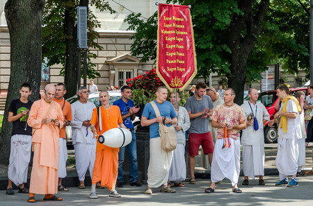 krishna: Believers of the Society for Krishna Consciousness in the center of Lviv in Ukraine, near the Opera House plays drums, harmonica and other instruments and sing Hindu mantra Hare Krishna