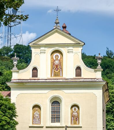 main entrance: The main entrance to the temple of the martyr Clement Sheptytsky with icons, windows and a cross in Lviv Stock Photo