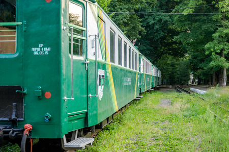 turnout gear: Lviv, Ukraine - August 2015: Railway train carriages breeze on the childrens railway in Striysky Park in Lviv
