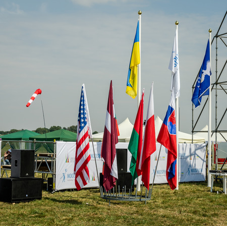championships: Lviv, Ukraine - August 2015: FAI European championships for space models 2015. Flags of the participating teams