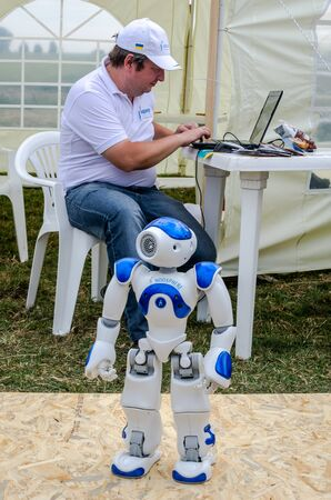 managed: Lviv, Ukraine - August 2015: FAI European championships for space models 2015. The robot Noosphe managed by the operator remotely via computer