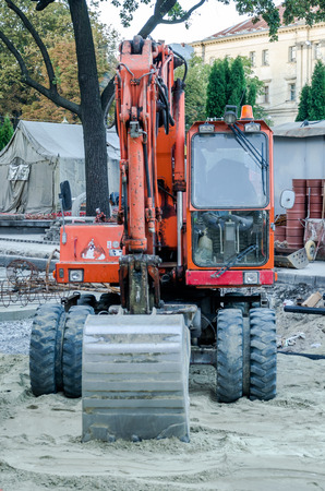 pits: Tractors are digging pits to repair roads in Lviv