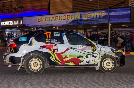 adrenaline rush: Lviv, Ukraine - Otober 2015: Racing rally car driving on the asphalt road on the night stage, which is controlled by the driver of pilot and navigator on a bend turning