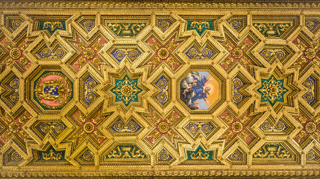 purgatory: The pattern of the ceiling with a gold-painted statues of saints and icons in the Basilica of Santa Maria in Trastevere Stock Photo