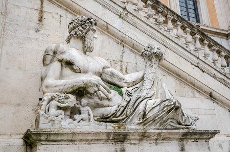 statue: Statue on the fountain in the square del Campidoglio of Rome, capital of Italy