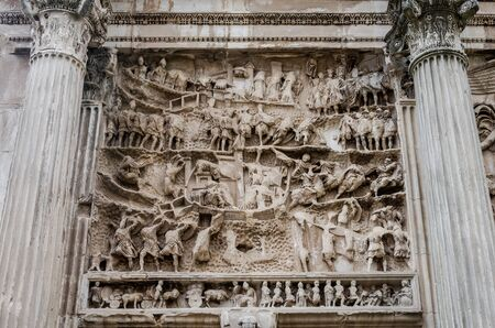 severus: Element pattern of sculptures on a triumphal arch of Septimius Severus with stone columns in the Roman Forum in Italy