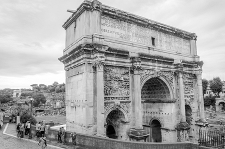severus: Roma, Italy - October 2015: Tourists walk and take pictures in the photo on the tour of the ancient ruins of the ancient imperial capital of the Roman Forum and Arch of Septimus Severus in Rome, Italy Editorial