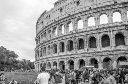 historical sites: Roma, Italy - October 2015: Foreign tourists on trips walk photographed and consider the main historical sites in the Italian capital Rome, the ruins of the Colosseum
