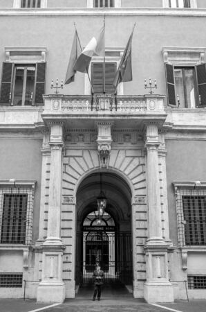 sud: Italian carabiniere policeman guards the entrance at a public institution in a historic building Fondazione con Il Sud in Rome with the flags of Italy and the European Union Editorial