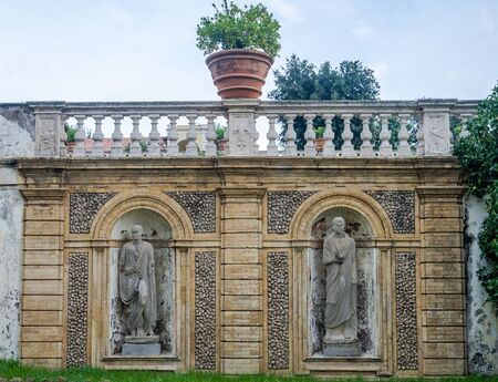 generals: Stone sculpture monument to the two emperors generals with flower beds in park at Villa Pamphili in Rome, capital of Italy