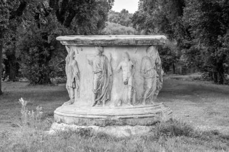 senators: Marble stele stone pedestal with sculptures of ancient images of emperors and senators in park at Villa Pamphili in Rome, capital of Italy Stock Photo