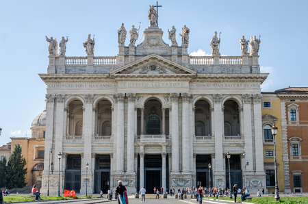 bible altar: Roma, Italy - October 2015: Foreign tourists strolling and being photographed on an excursion near the main entrance Basilica di San Giovanni in Laterano