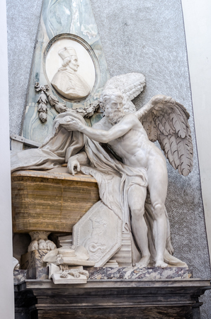 purgatory: Marble statue of an angel with wings in Basilica di San Giovanni in Laterano in Rome, capital of Italy Stock Photo