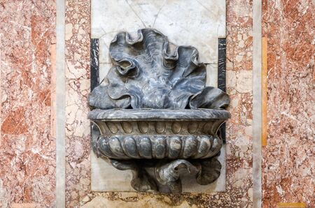 purgatory: The marble bowl in the shape of a flower which is the holy water in Basilica di San Giovanni in Laterano in Rome, capital of Italy