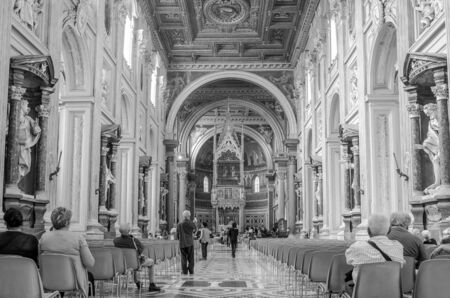 commandment: Roma, Italy - October 2015: People pilgrims pray and consider on trips historical sculptures and icons in Basilica di San Giovanni in Laterano in Rome, capital of Italy