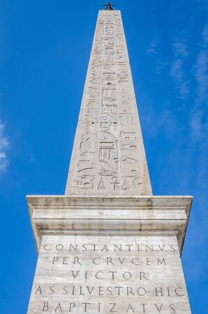 obelisco: Marble monument Obelisco Lateranense to ancient hieroglyphs and inscriptions on the square Giovanni Paolo 2 in the capital of Italy, Rome Editorial