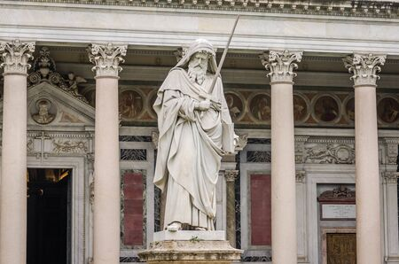 purgatory: Marble statue of the apostle in the church yard of the Cathedral Basilica of St. Paul Fuori le Mura in Rome, Italy