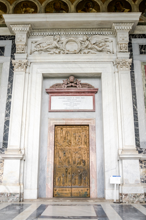 purgatory: Marble door with wrought iron pattern of the saints in the church yard of the Cathedral Basilica of St. Paul Fuori le Mura in Rome, Italy