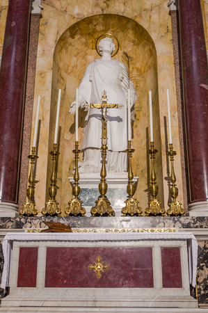 apostle paul: The altar with the holy apostle among candles in the catholic church cathedral basilica of Saint Paul in Rome, Italy
