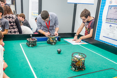 cipher: ROMA, ITALY - OCTOBER 2015: Engineers, developers have programmed robots to play football