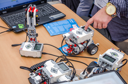 programmable: ROMA, ITALY - OCTOBER 2015: Engineers tested programmable robots Lego toys Editorial