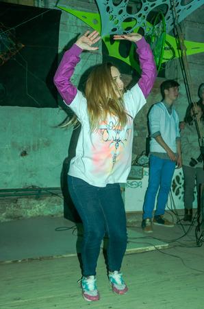 breakdance: LVIV, UKRAINE - DECEMBER, 2015: Performance on stage dancer girl in the style of breakdance Editorial