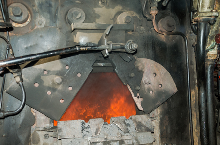 reserved seat: Furnace motor for coal combustion and the fire in the old Soviet vintage retro steam train
