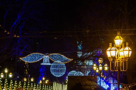 fairs: Christmas fairs with garlands and old vintage retro forged lantern on the street of Lviv