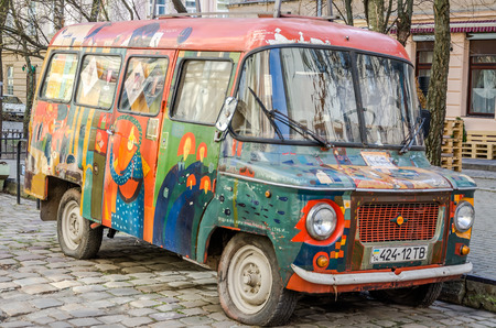 abandoned car: LVIV, UKRAINE - MARCH 2016: Old vintage retro abandoned car painted graffiti artists in the hippy style is broken on one of the streets of Lviv