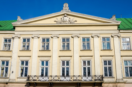 double glazing: Lviv regional administration building with columns, windows and balcony on a sunny day Stock Photo