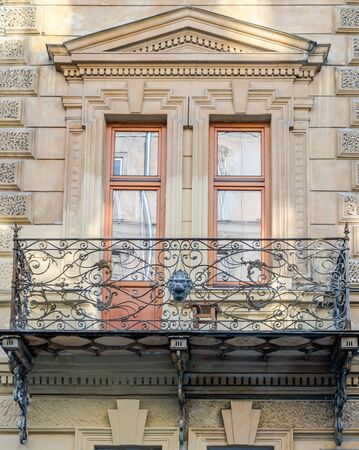 double glazing: Old vintage retro balcony with columns and ornaments on an old building with windows on one of the streets of Lviv, Ukraine